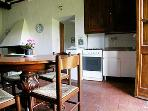FATTORIA - Dining/cooking area. In the center is the door to bedroom B.