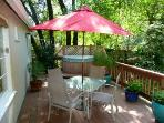 Rear Deck with picture of hot tub; privacy and seclusion are the hallmarks of a great property.