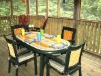 Our screened porch is sure to be the site of family fun dinners