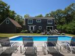 Professionally landscaped pool area offers full sun and complete privacy.