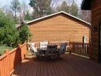 Front deck with grill and enough sitting for 12 people right out the door of our beautiful chalet