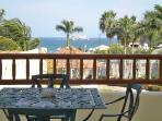 Table on balcony has ocean views-perfect for drinks or meals