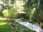 Lawn, flower beds, picnic table/benches, granite pathway.