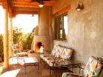 Expansive views from portal with outdoor kiva fireplace