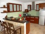 Large fully equipped kitchen with bar stools