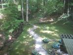 What a view! Creek, stone path into the woods and musicians playing their tunes in the fern grotto!