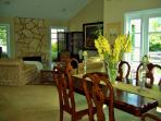 Dining room with access to the outdoor fire place and water fall