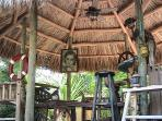 With the breeze of the water, the fan and the shade of the tiki this is a great place to chill and have a cool drink