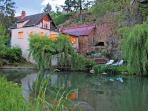 DISCOUNTS! Riverfront House in Old-World Burgundy