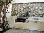 Build in gas BBQ grill with sink & food prep area located just beside the palapa