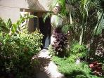 Lush Tropical Courtyard Entry, Private, Out of View of Car which is Close Behind Wall
