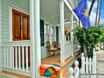 Furnished, Tiled Front Porch Beckons you to a Peaceful Retreat.