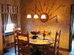 Dining Room with swords and mace ready and at hand should the castle be attacked during a meal.