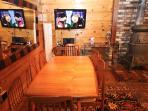 Dining area with 42'' Sony Bravia flat screen TV set and resizable dining table good for 6-10 people