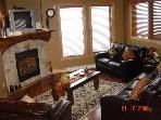 Relaxing Living Area, with Rock Fireplace and Leather Sofas