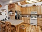 Country style kitchen with breakfast bar