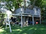 Tree House with Lake View includes two bunks, TV/DVD, Heat, Ceiling fan, and Deck overlooking lake