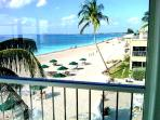 View of 7 mile beach from Oceanfront Dining Room Large Glass Window