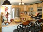 All new Kitchen with Eating Bar, Stainless Appliances, Hand-Painted Dishes, Quality Cookware
