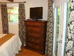 Queen Bedroom with Gorgeous Chest of Drawers, HDTV, Elegant Curtains
