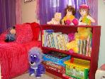 Colorful Kids Play Area with Twin Bed, Stuffed Animals, Games, Books & Toys