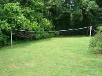 Back yard with badmitten net...big lawn to play games, croquet, and more.