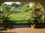 West Coast Villa I Gardens and roofed over patio great for outdoor BBQ's and relaxation