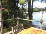 Deck looking sourhwest across the cove (left of photo 26) ahowing bird feeders