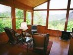 The Professionally Decorated Sunroom, overlook in the View of Cow Rock