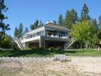 Big Bear Lakefront Cabin has beautiful views of the lake from inside and outside along the large deck.