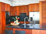 kSolid Mahoghany wood kitchens have stainless steel appliances, Jennair cooktop, granite countertops