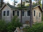 Back side view of cottage from water side.