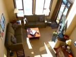 looking down into your living area from the loft bedroom - afternoon sun streams onto your living area in the...