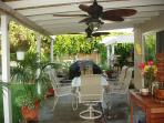Covered patio w/2 ceiling fans, stone dining table for 6, stainless steel gas Bbq grill