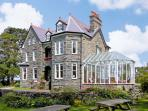 PENSARN HALL, pet friendly, character holiday cottage, with a garden in Llanbedr, Ref 7117