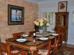 Dining Table and room. Seats 8 -12. Table has glass top for your ease of use.