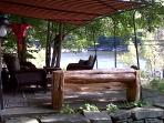 Shaded front porch with lake view