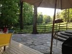 Back deck with a stone patio