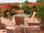 Our patio furniture is comfortable and blends in nicely with the red rocks