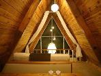Loft at night.  Has curtains at balcony for privacy.