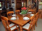 Large dining table, plenty of tableware and glassware for all.