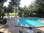 Relax by the pool, in sun or shade, surrounded by  golf  course and lagoon views