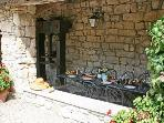 The Loggia with the old Wine Press, and the table set for dinner