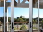 French doors open onto front porch