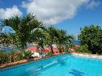 Spacious Le Marlin offers beautiful sunset and harbor views, pool & US Satellite
