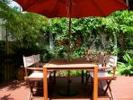 Outdoor dining for 4-6 on backyard deck