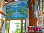 Hand Painted Mural of Lake Arenal. Guitar and othe instruments for your enjoyment, play some music