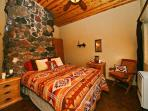 Zion Estate: Bedroom 1 with 1 Queen bed. This bedroom is named 'Glohearth'