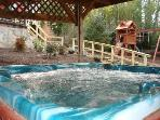 6 Person Hot Tub under cover and fenced for privacy