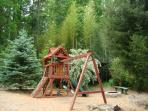 Kids playground with fort, slide, swings & climbing wall